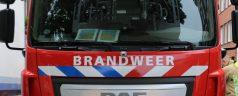 Brandweer redt mensen uit portiekwoning in Rubroekstraat